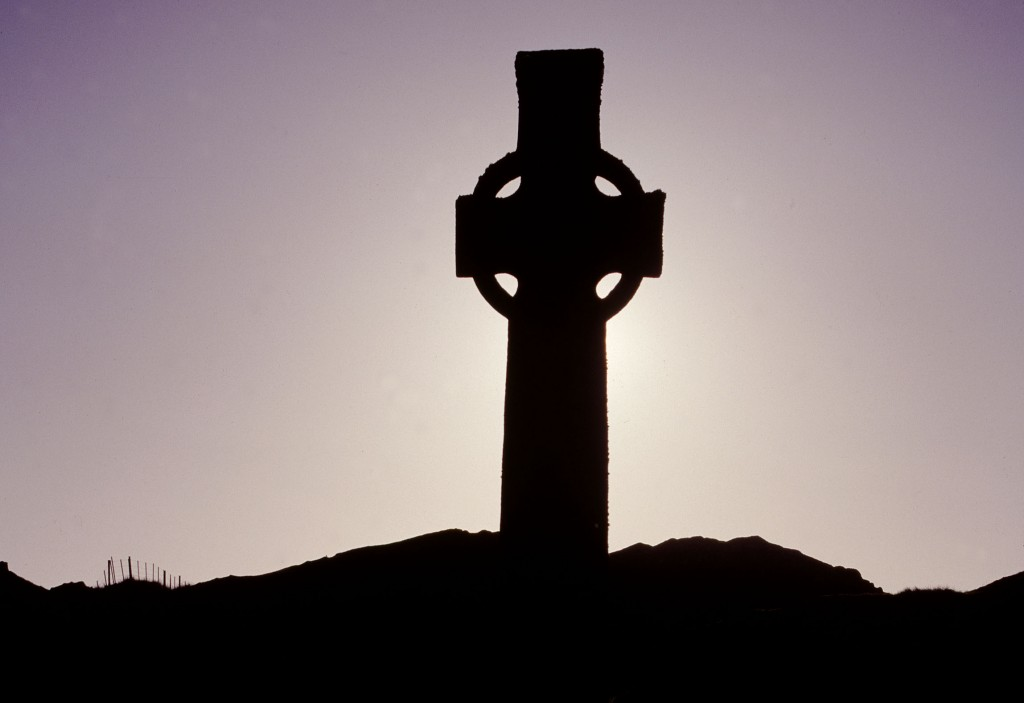 A celtic cross at sunset
