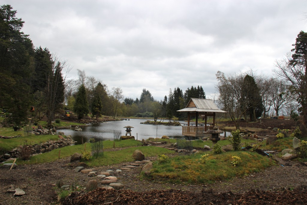 The garden at Cowden showing the newly constructed rest house at the edge of the lake