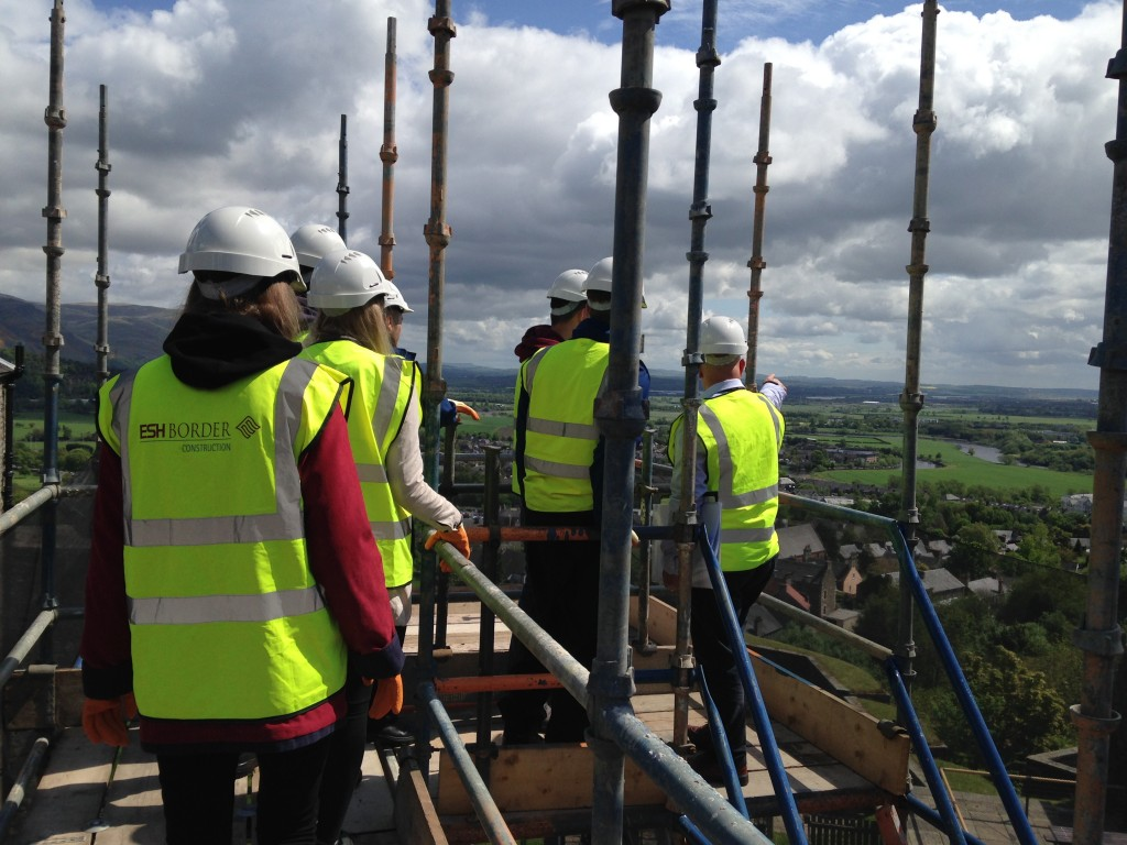Summer School attendees admiring the view from on top the scaffolding