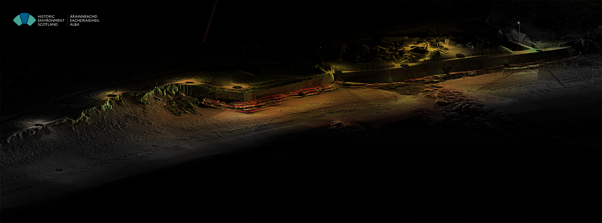 General view of the point cloud at Skara Brae from the NE, showing the protective sea wall and sand dunes to either side of it. The Neolithic village is visible at the top right part of the image.