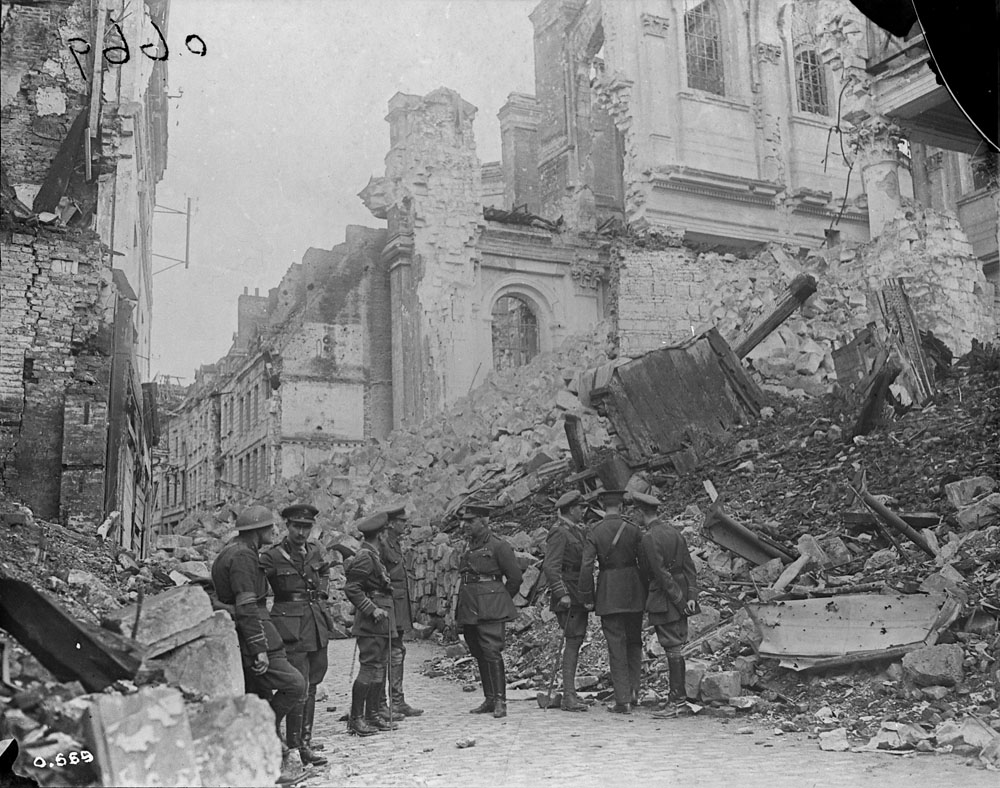 The same group of Canadian officers inspecting the rubble on Rue Méaulens