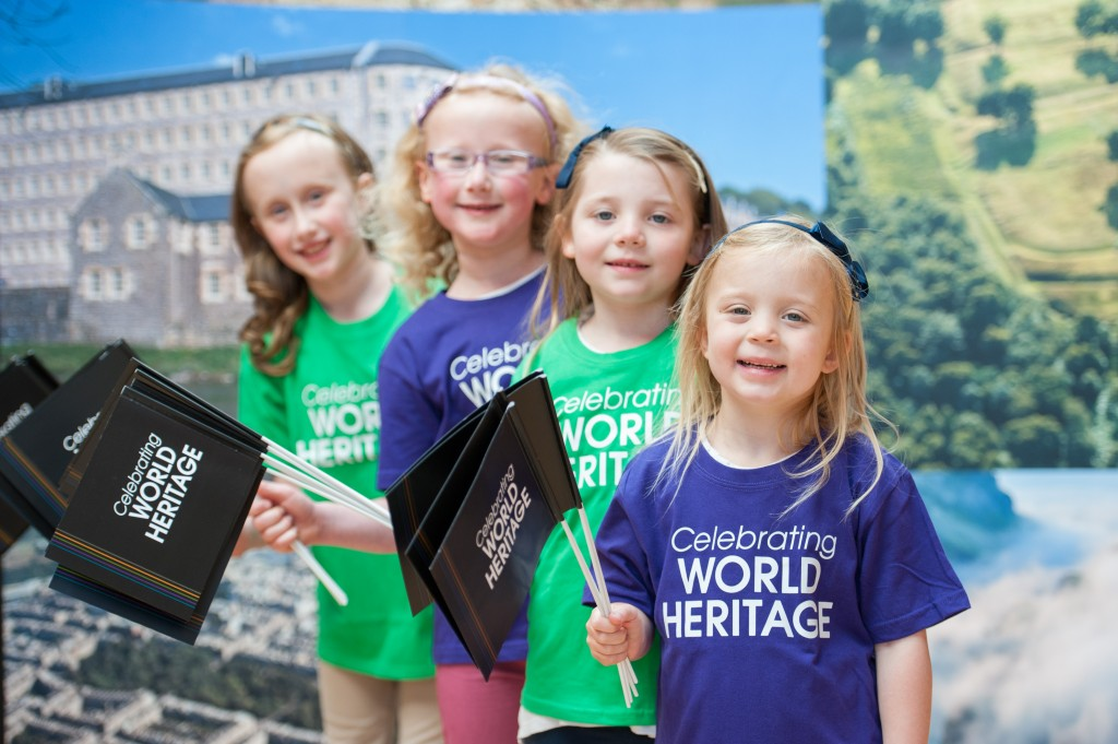 Four young girls in World Heritage Day T shirts