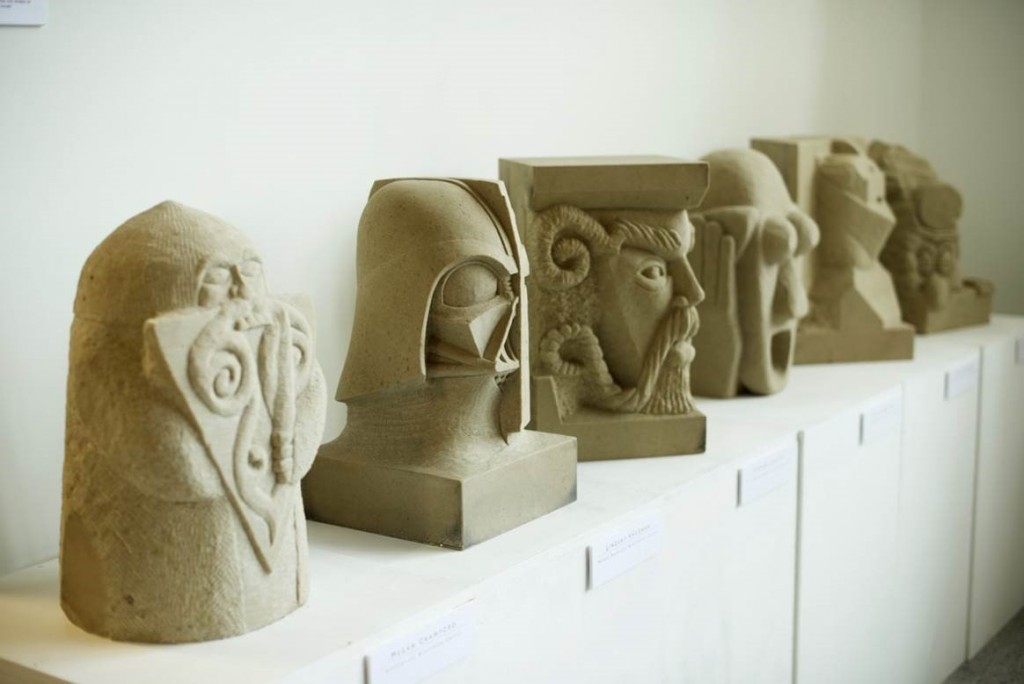 Five stone sculptures in a row