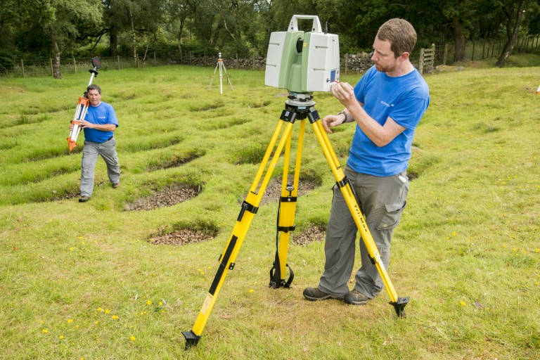Historic Environment Scotland member of staff James Hepher using a laser scanner to digitally document the Antonine Wall