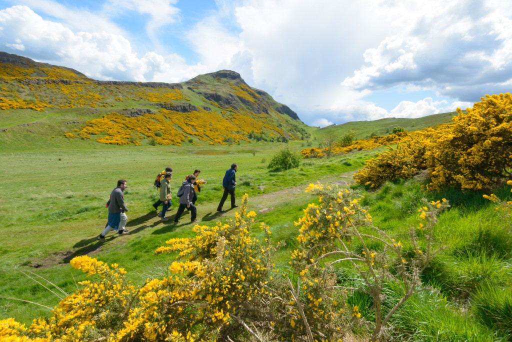 A ranger taking a group on a walk around Holyrood Park