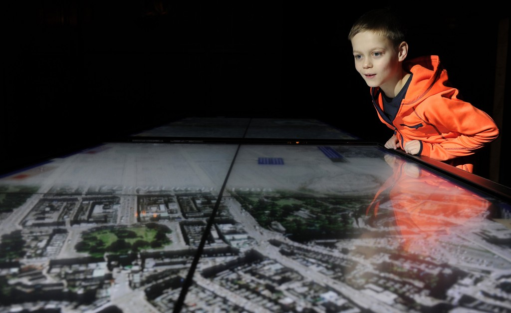 A young visitor explores the stories of Edinburgh and Nanjing in A Tale of Two Cities exhibition at Edinburgh Castle in December 2015