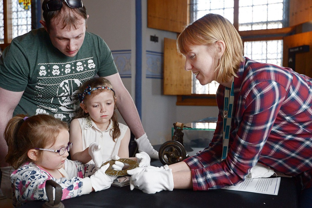 A family inspecting objects at the collections stall at In Vogue