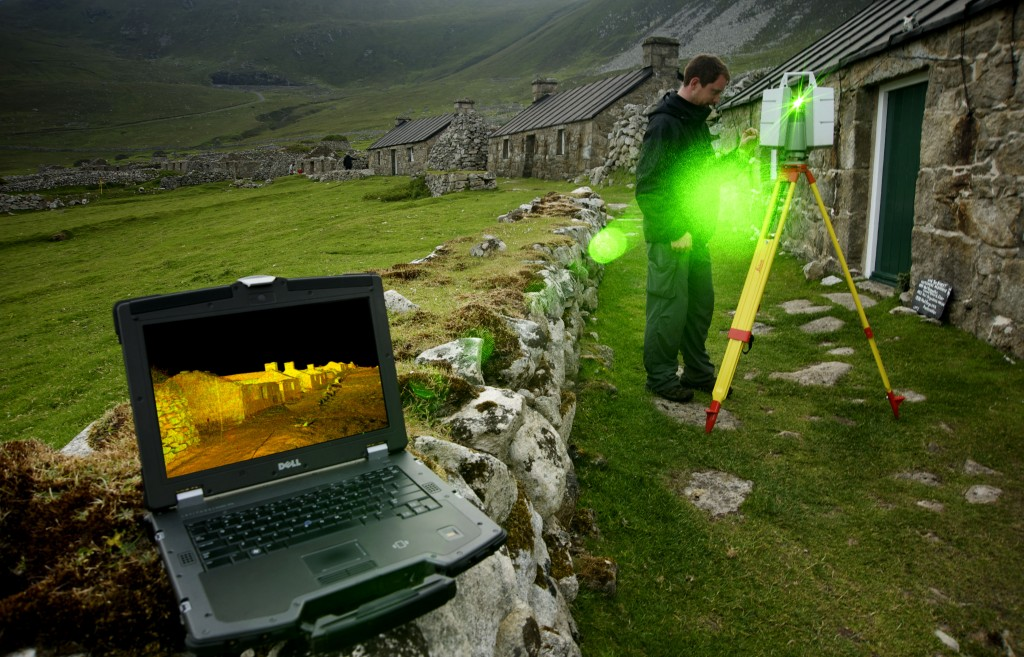 A man scanning houses on St Kilda with a special laser scanner