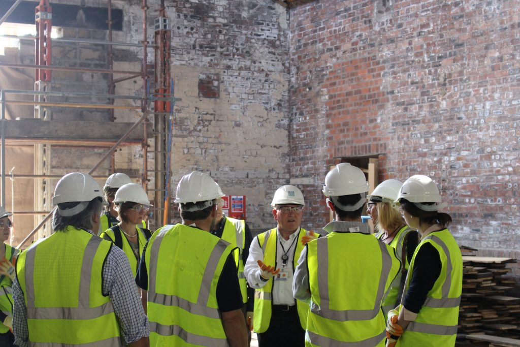 The Group look at the exterior and interior features of the site