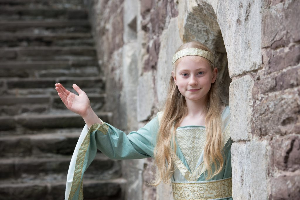 a young girl dressed in a renaissance dress