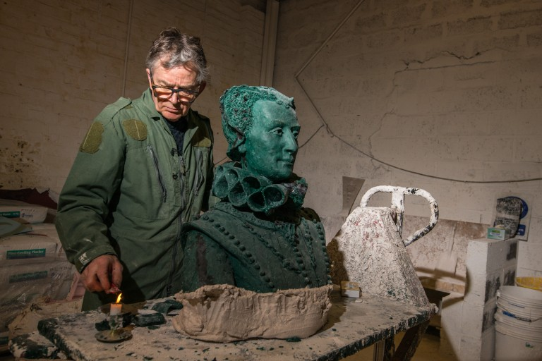Sculptor David Annand working on a statue of Mary Queen of Scots