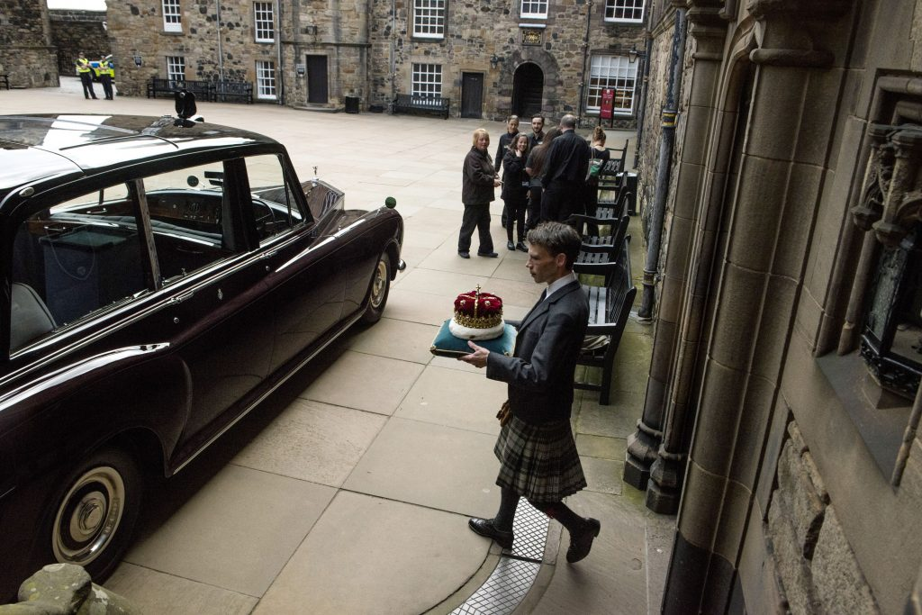 The Duke of Hamilton with the 500 year old Crown of Scotland in the Crown courtyard, Edinburgh Castle.
