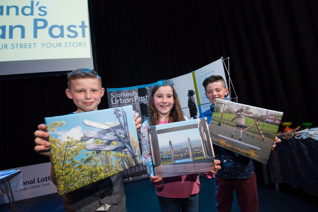 school children with photographs they took for the national record of Scotland to show future generations how Paisley looks today