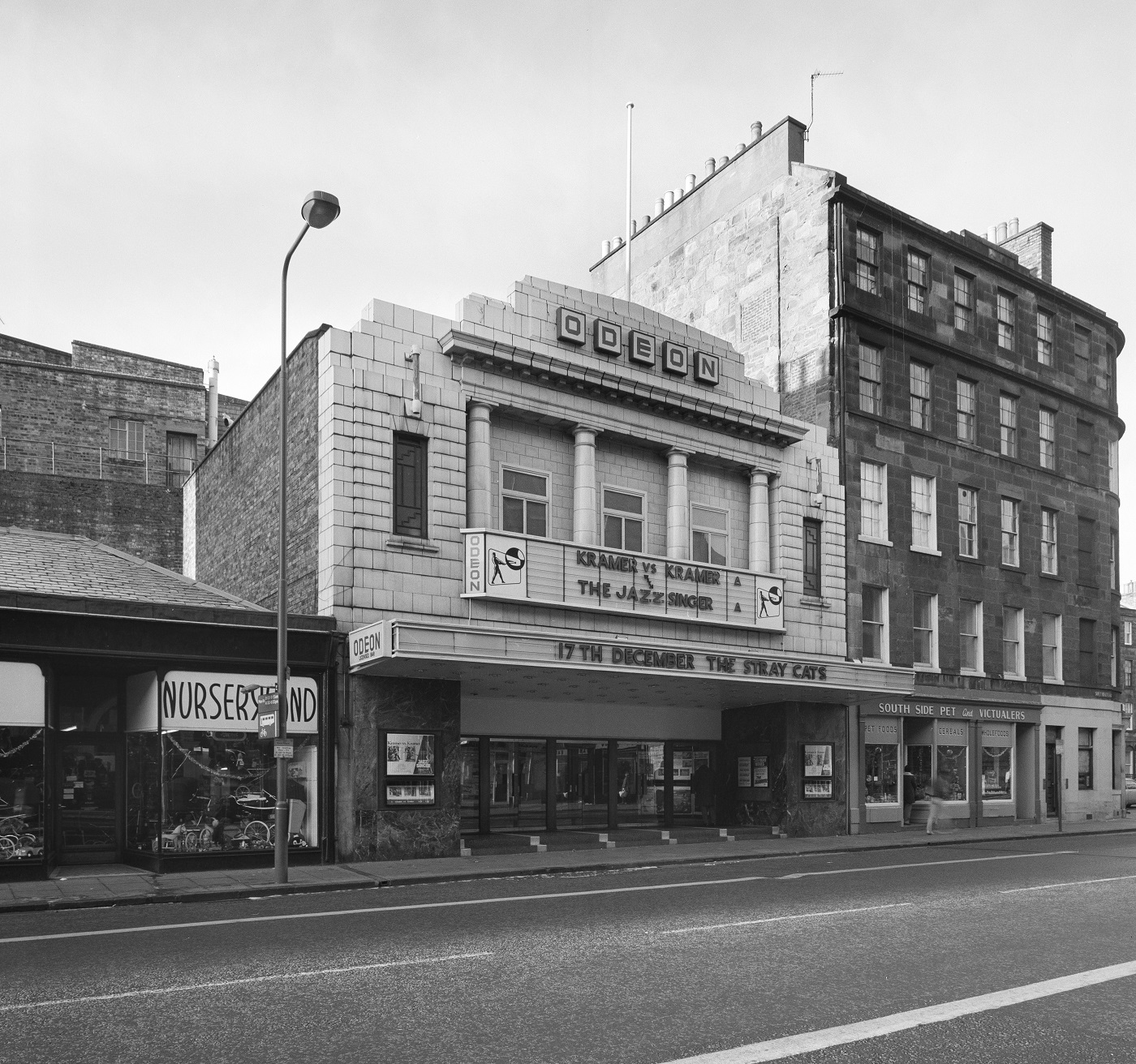 A black and white picture of the Odeon cinema