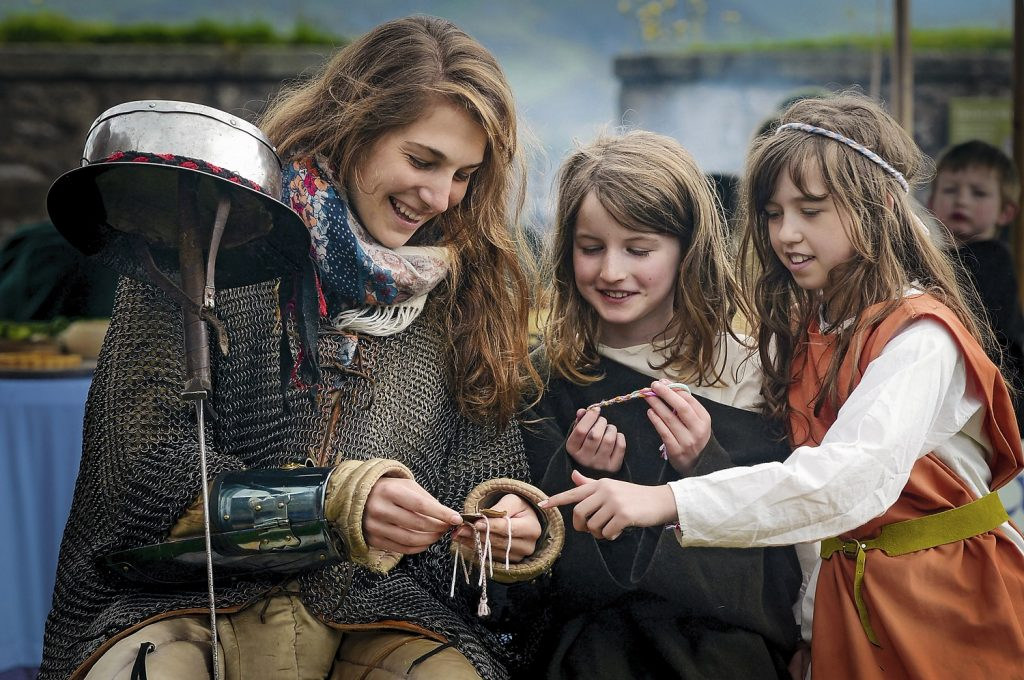 Visitors at Stirling Castle try on period costumes