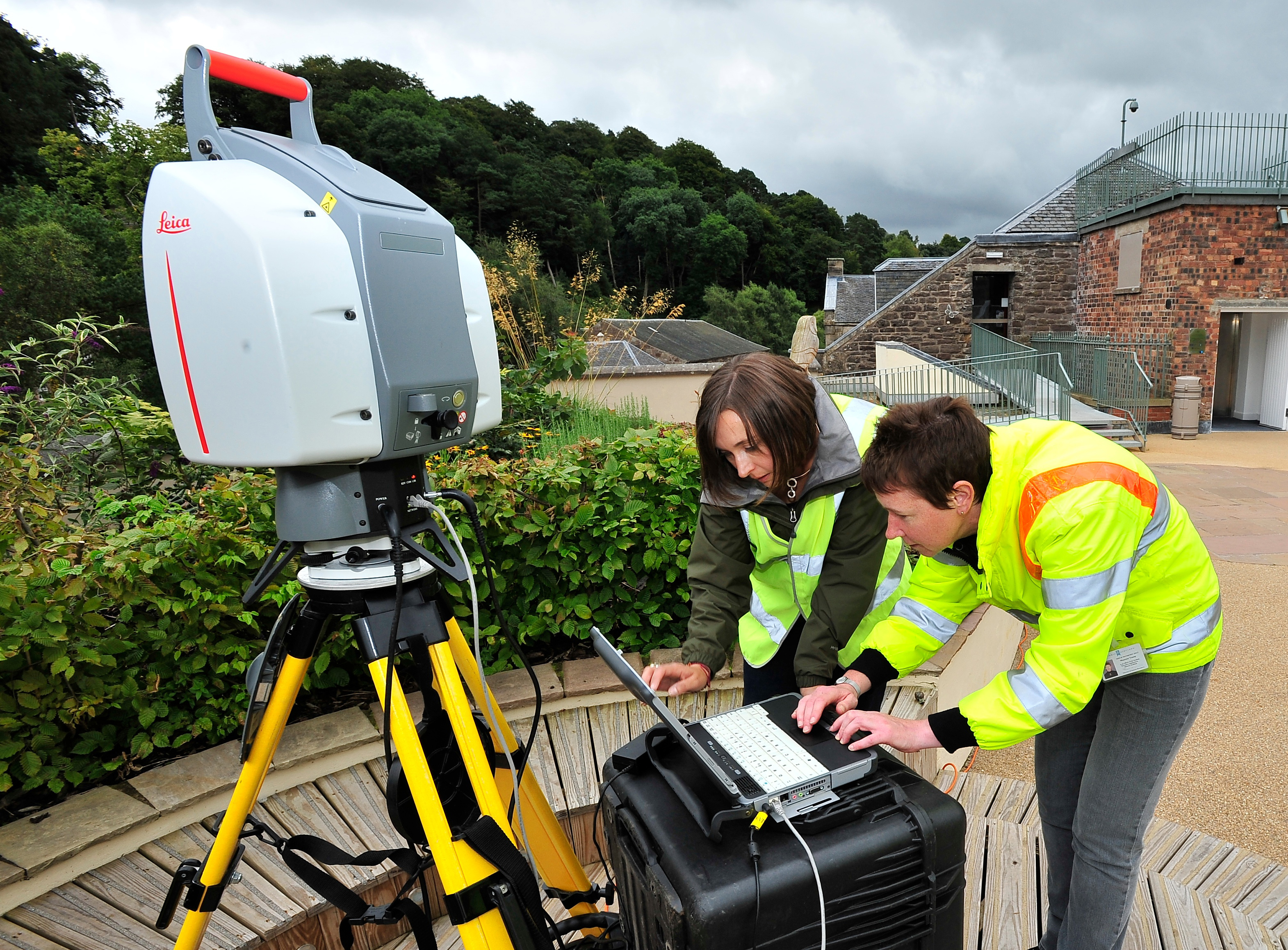 Two Scottish Ten surveyors scanning a part of New Lanark