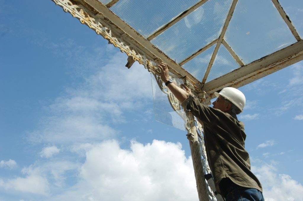 A man restoring a glass roof