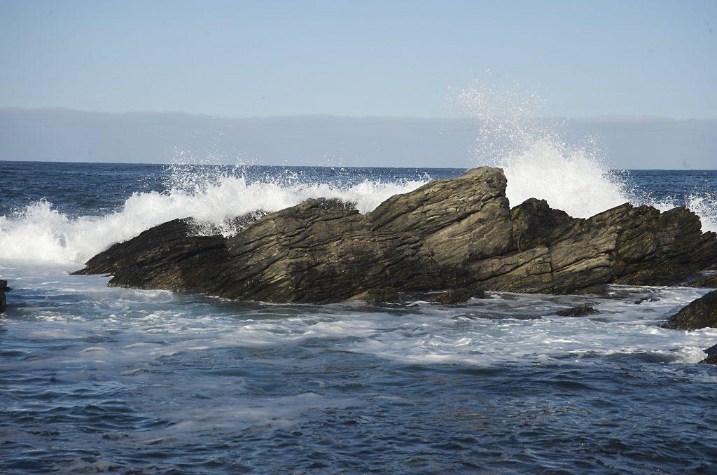 waves breaking on some rocks
