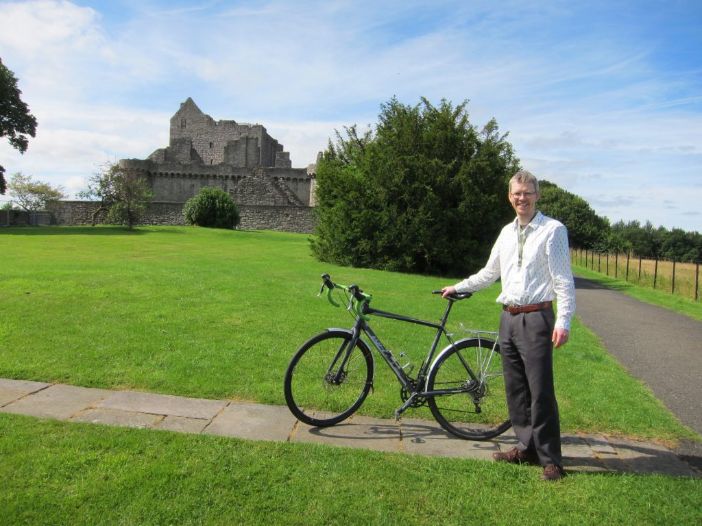 Gareth and his bike in front of Craigmillar Castle