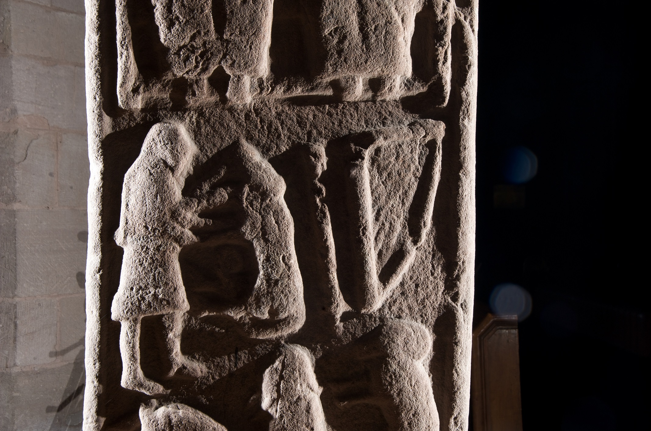 Detail of the back of the Aldbar Stone. This Pictish stone, now situated in Brechin Cathedral, shows the figures of David wrestling with a lion.