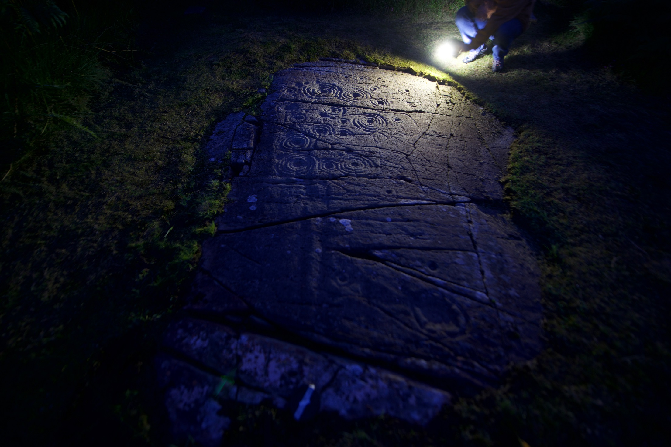 Cairnbaan rock marks in torch light