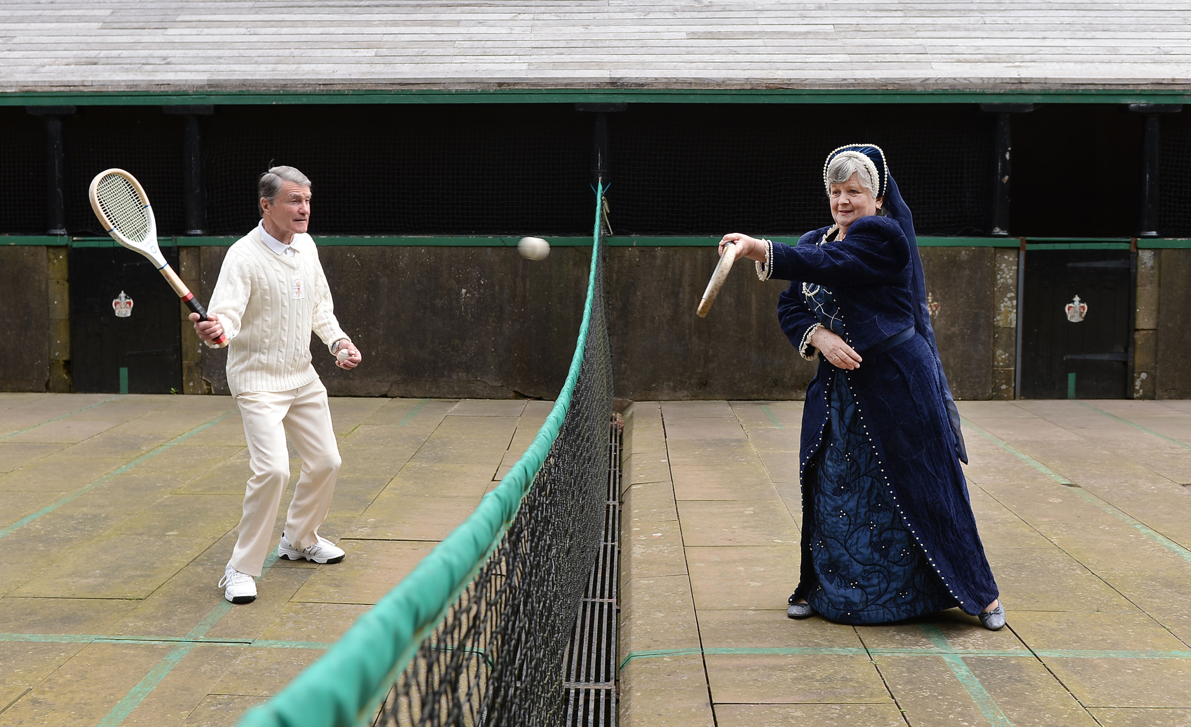 Two costumed characters playing tennis