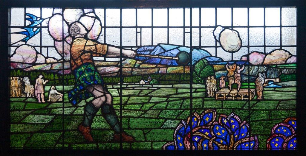 A stained glass window commemorating athlete Donald Dinnie at Huntly Arms Hotel, Aboyne.