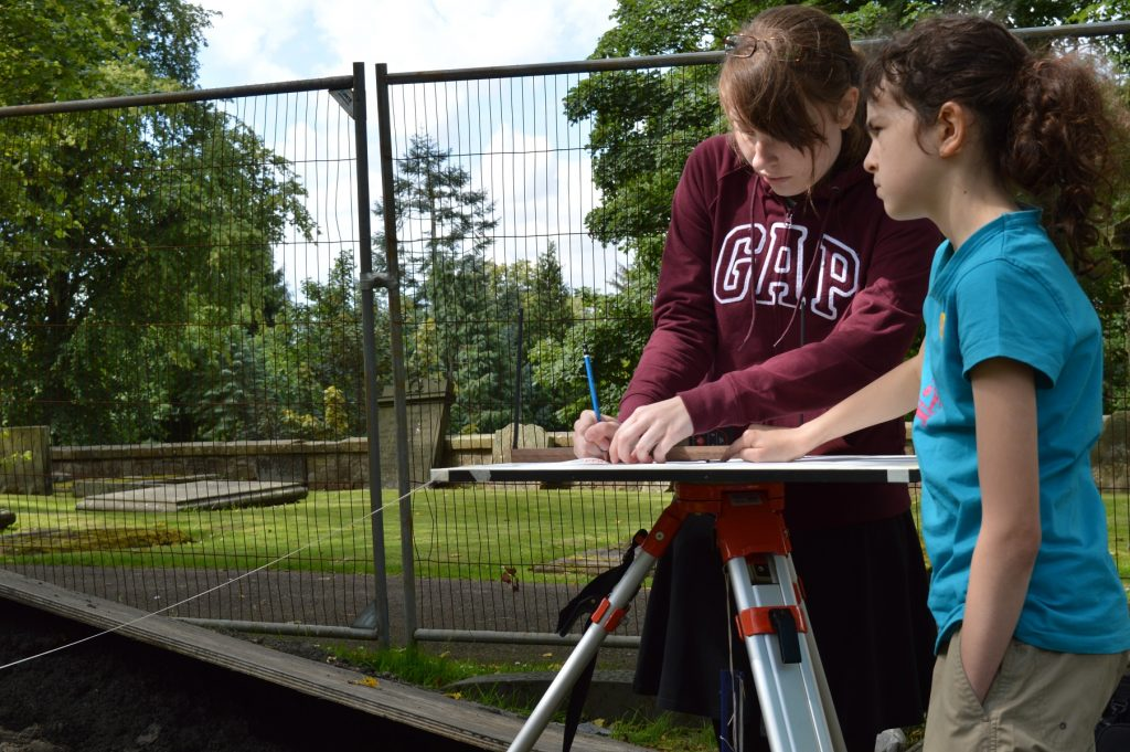 Two young women recording a site in Dunfermline