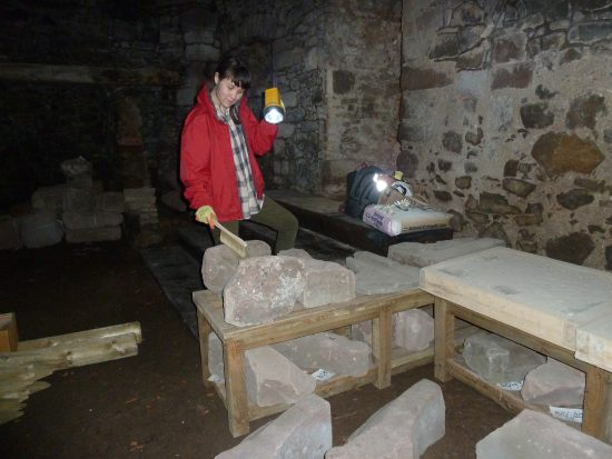checking and cleaning the architectural stones at Balvaird Castle