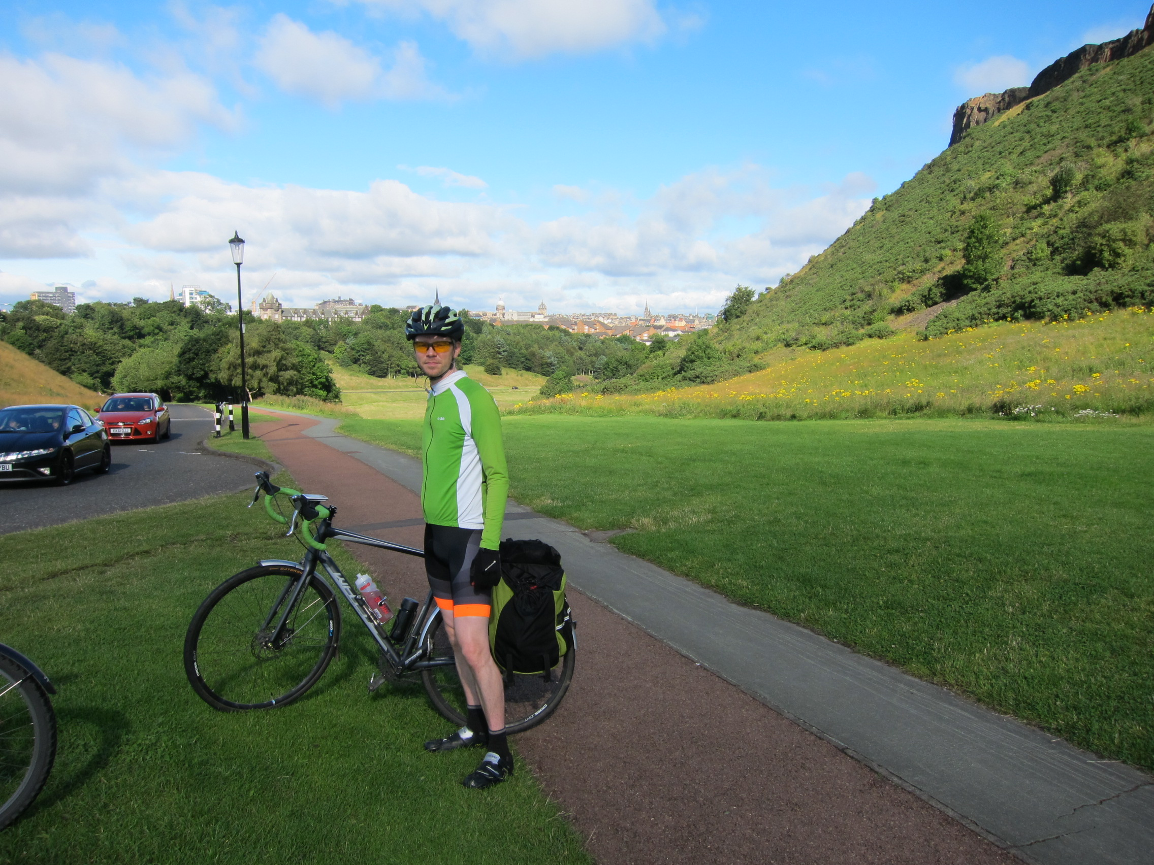 Gareth in cycle gear standing next to his bike in Holyrood Park