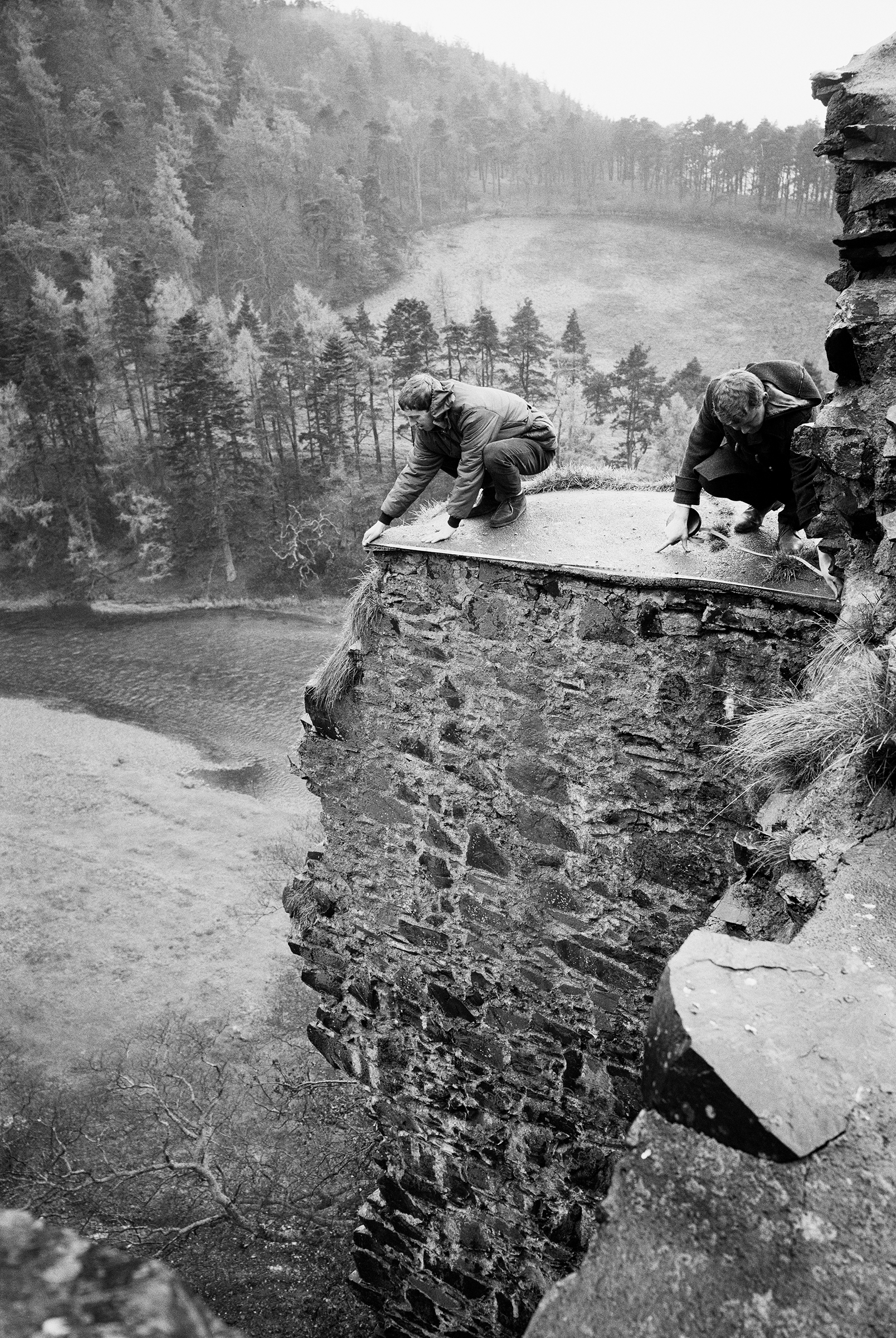Survey team in action at Neidpath Castle; left, Sam Scott, right, Douglas Fleming ©HES 'Health and safety was important in the 1970s, and Wallabee shoes are very non-slip.'