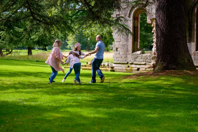 A family playing games at Dryburgh Abbey