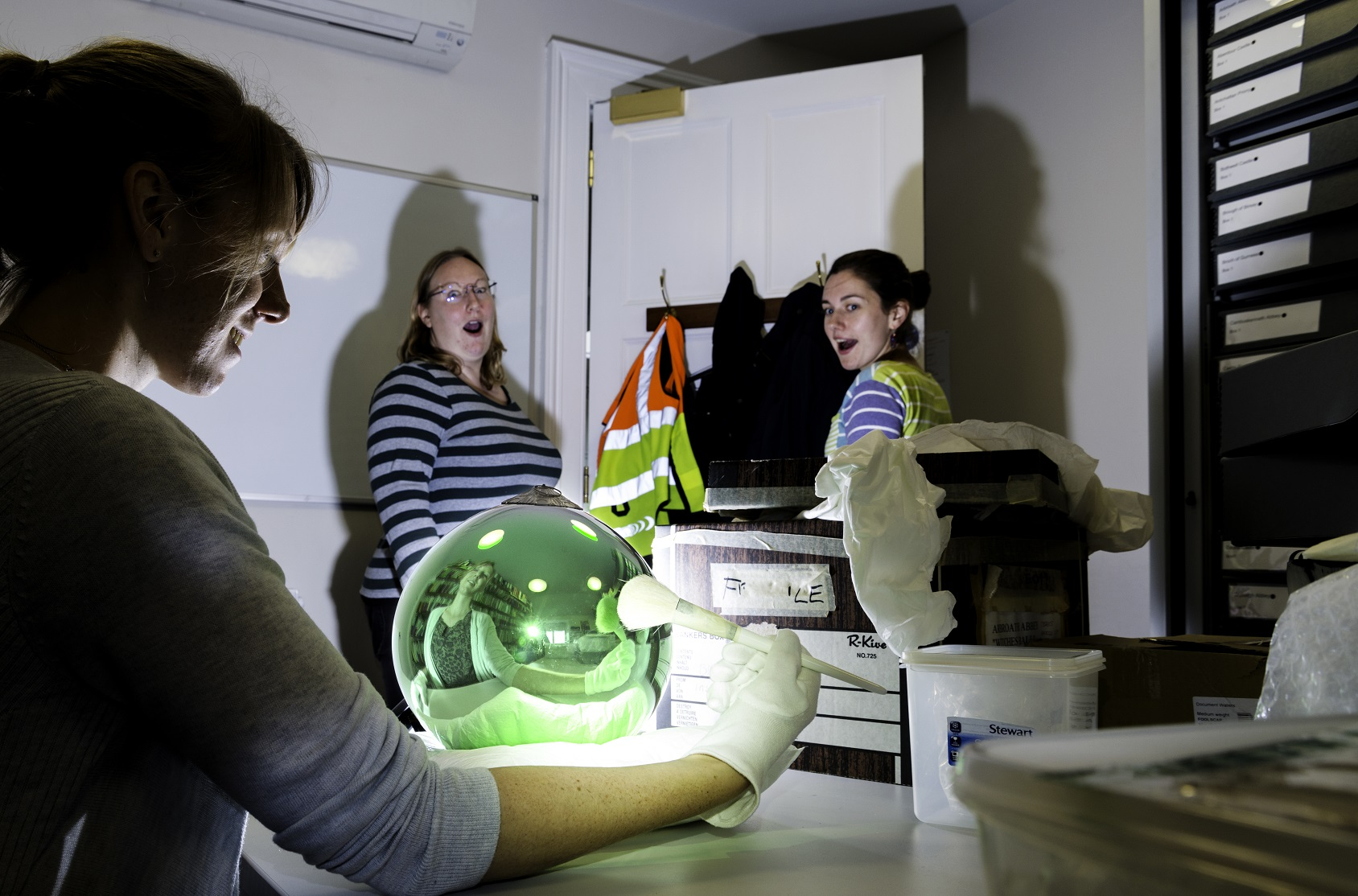 Members of the collections team tried out the 'witch ball'