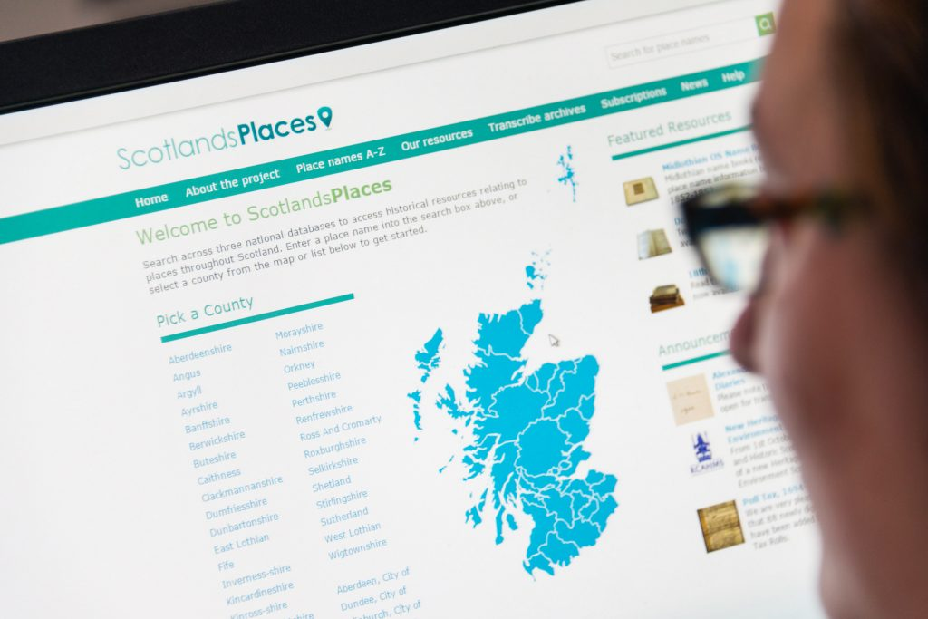 A person looking at a website called 'Scotland's Places'