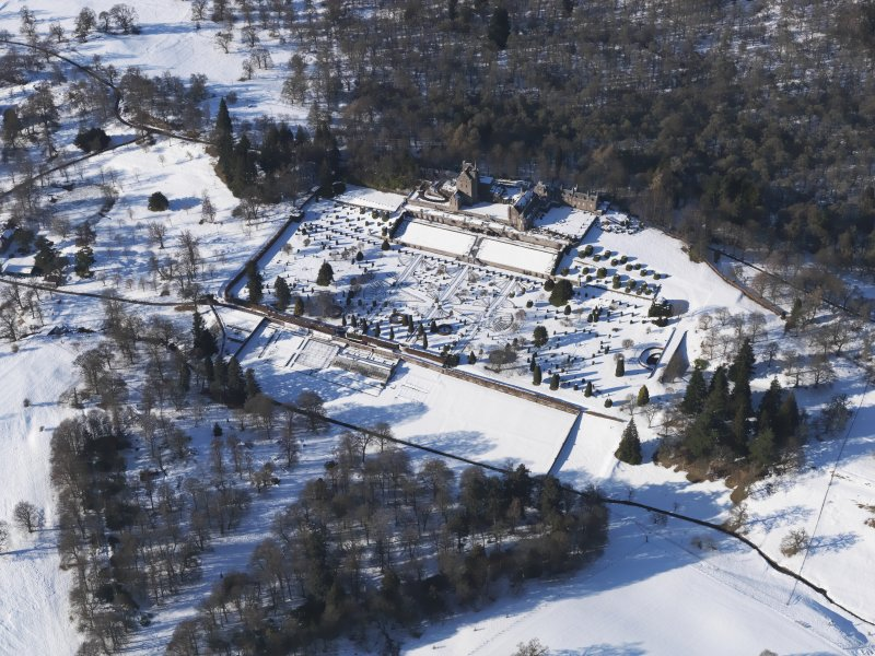 Oblique aerial view of Drummond Castle and gardens under snow