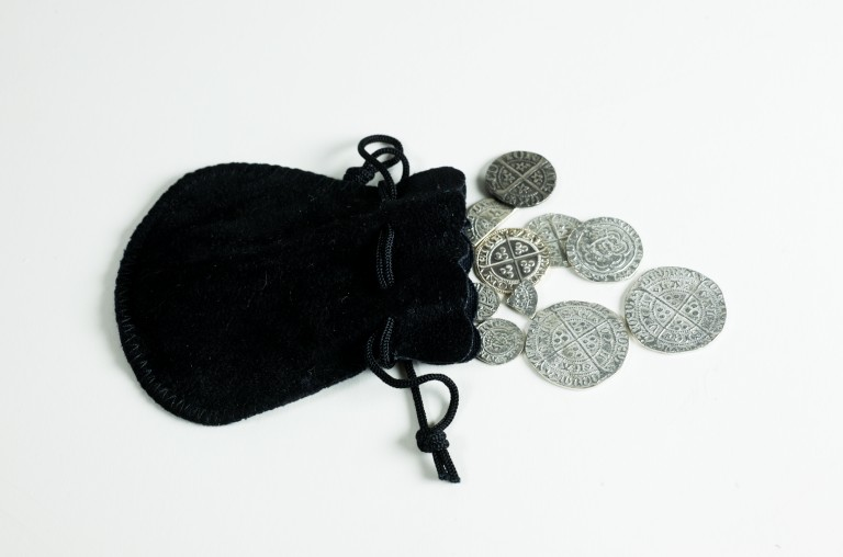 A black purse containing silver coins