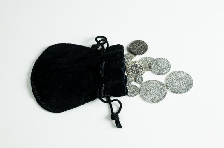 A black purse containing silver coins