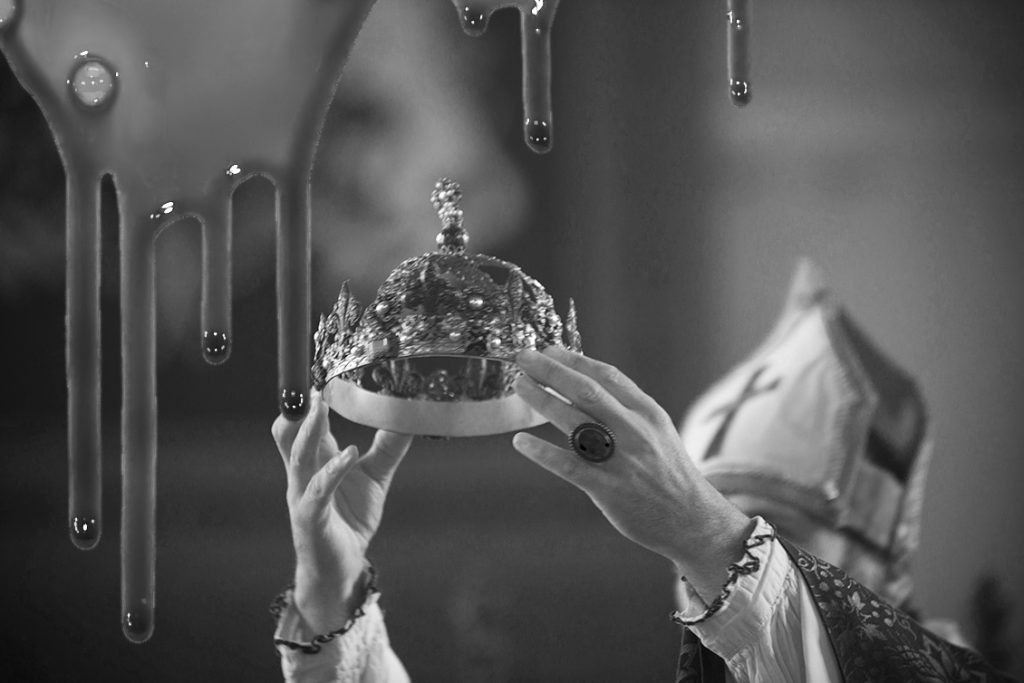 A crown being held up for a coronation