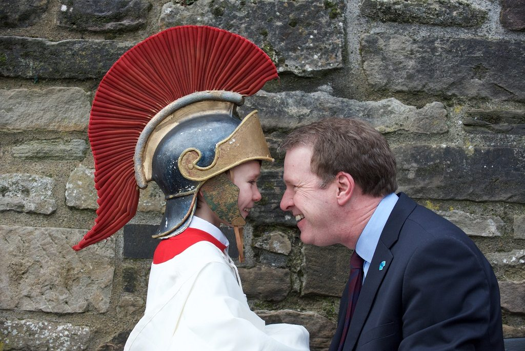 Chief executive Alex Paterson with a child dressed as a Roman