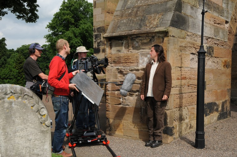 Neil Oliver filming at Dunfermline Abbey