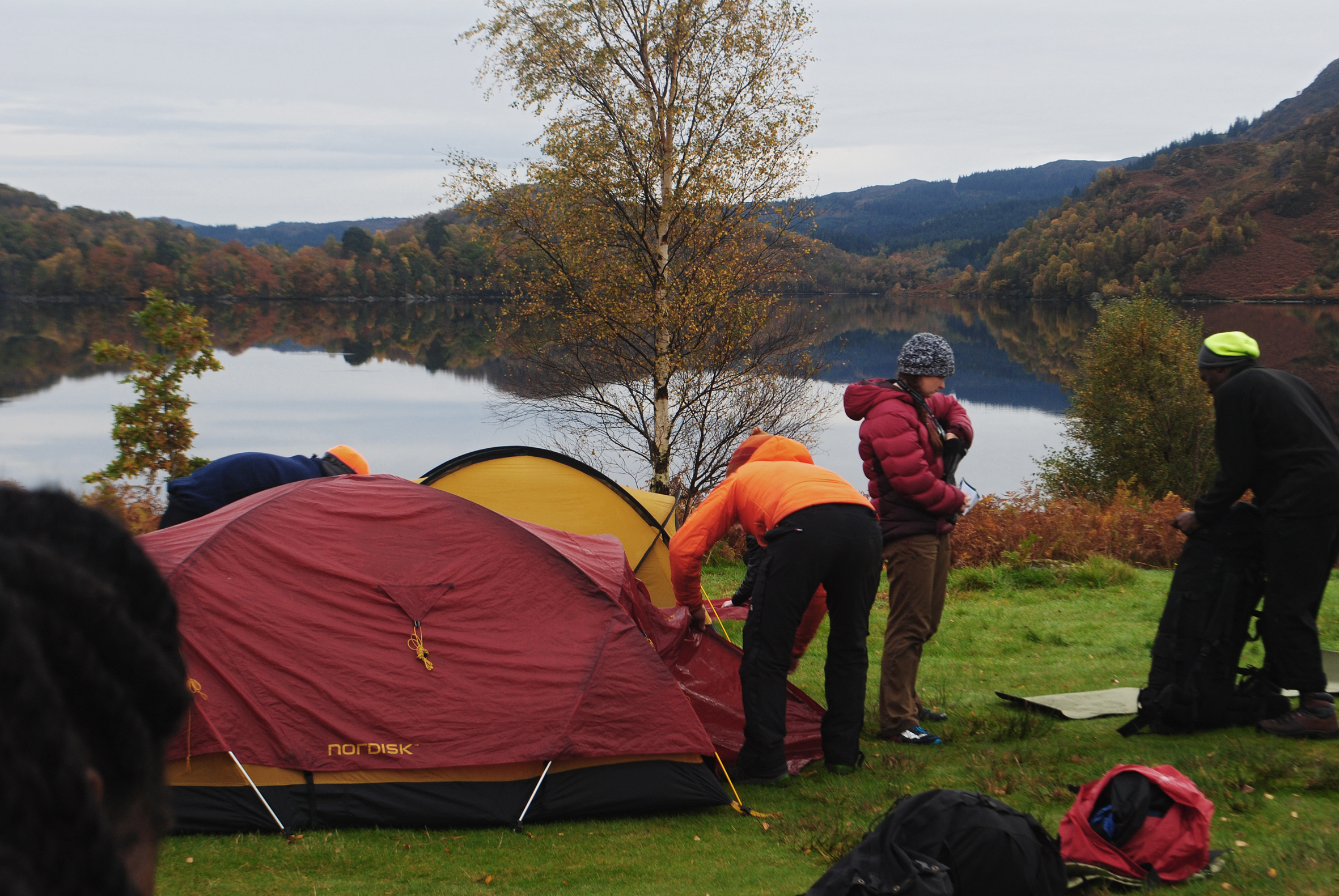 The young carers are setting up camp on the shores of a loch