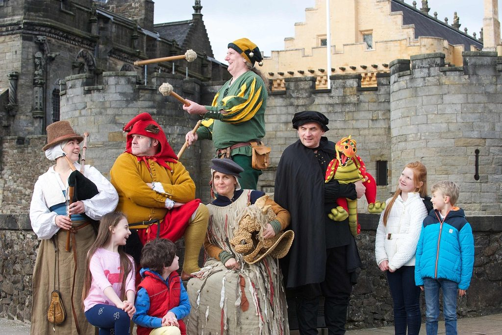 A group of costumed performers in front of Stirling Castle