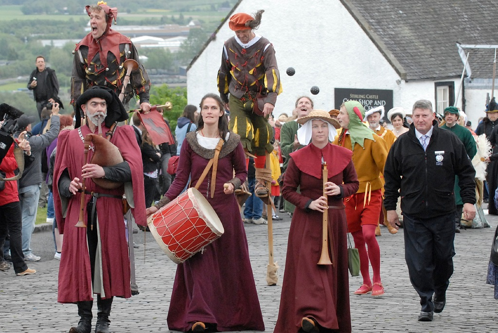 A parade of costumed performers on the Stirling Castle esplanade