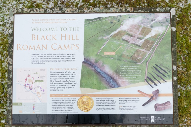 Interpretation panel with text and a drawing of a Roman camp