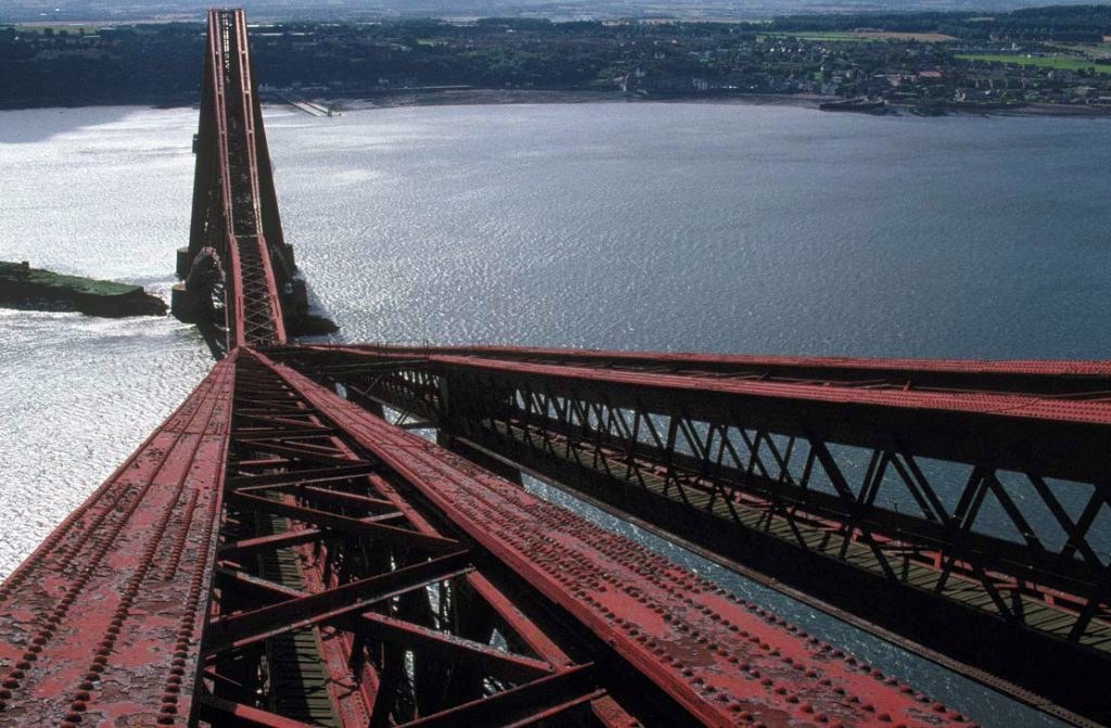 The Forth Bridge in 1989, when the old lead based paint had begun to fall off. Image by Miles Oglethorpe