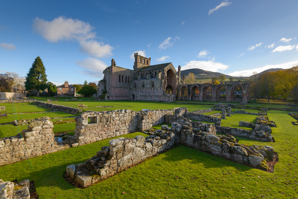A photograph of a ruined abbey on sunny day