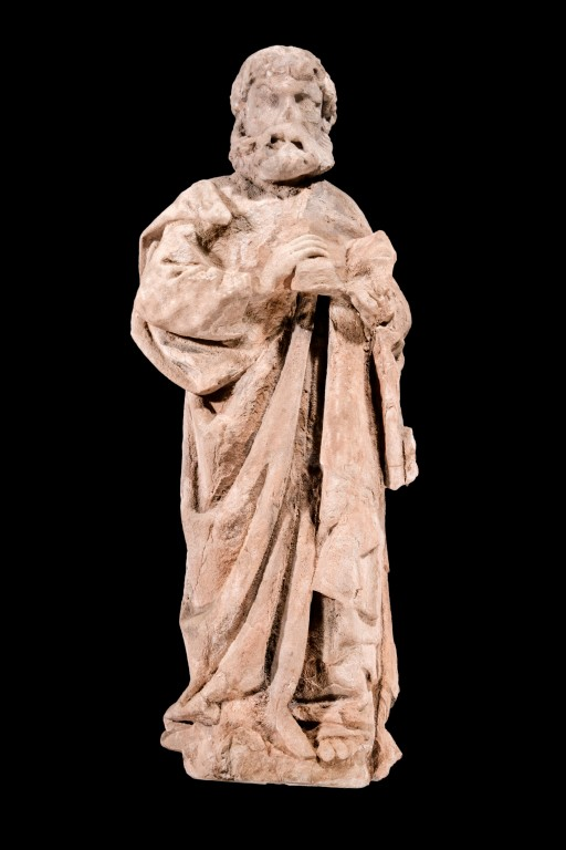A photograph of a statue of a man with a beard, dressed in robes