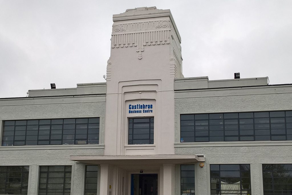 white art deco building with blue letters saying 'craigmillar business centre'