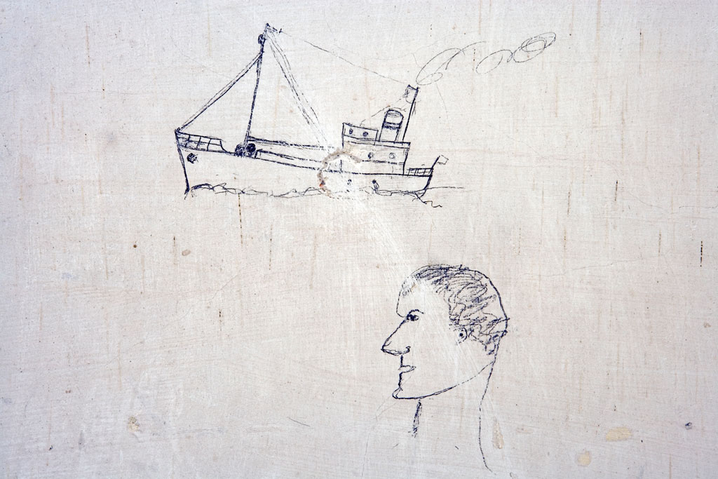 Image of a worker's doodle of a man looking at a boat