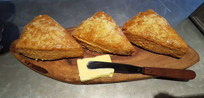 Freshly baked cheese scone platter with butter